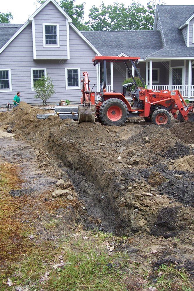 2013-5_progress_front_of_home_Here_we_have_a_trench_dug_for_the_electric_line_going_to_a_granite_lamp_post-min