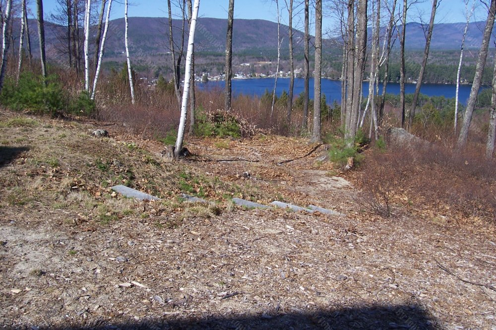 2013_6_before_view_of_patio_in_lower_wooded_area-min