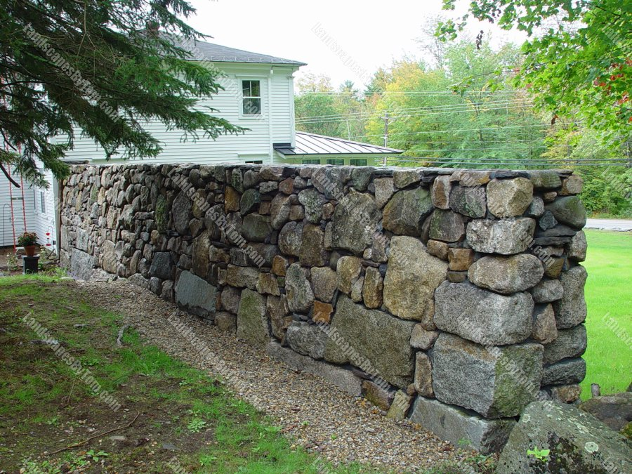 stone_Stone_Wall_as_a_Privacy_Fence_and_Sound_barrier_1-min